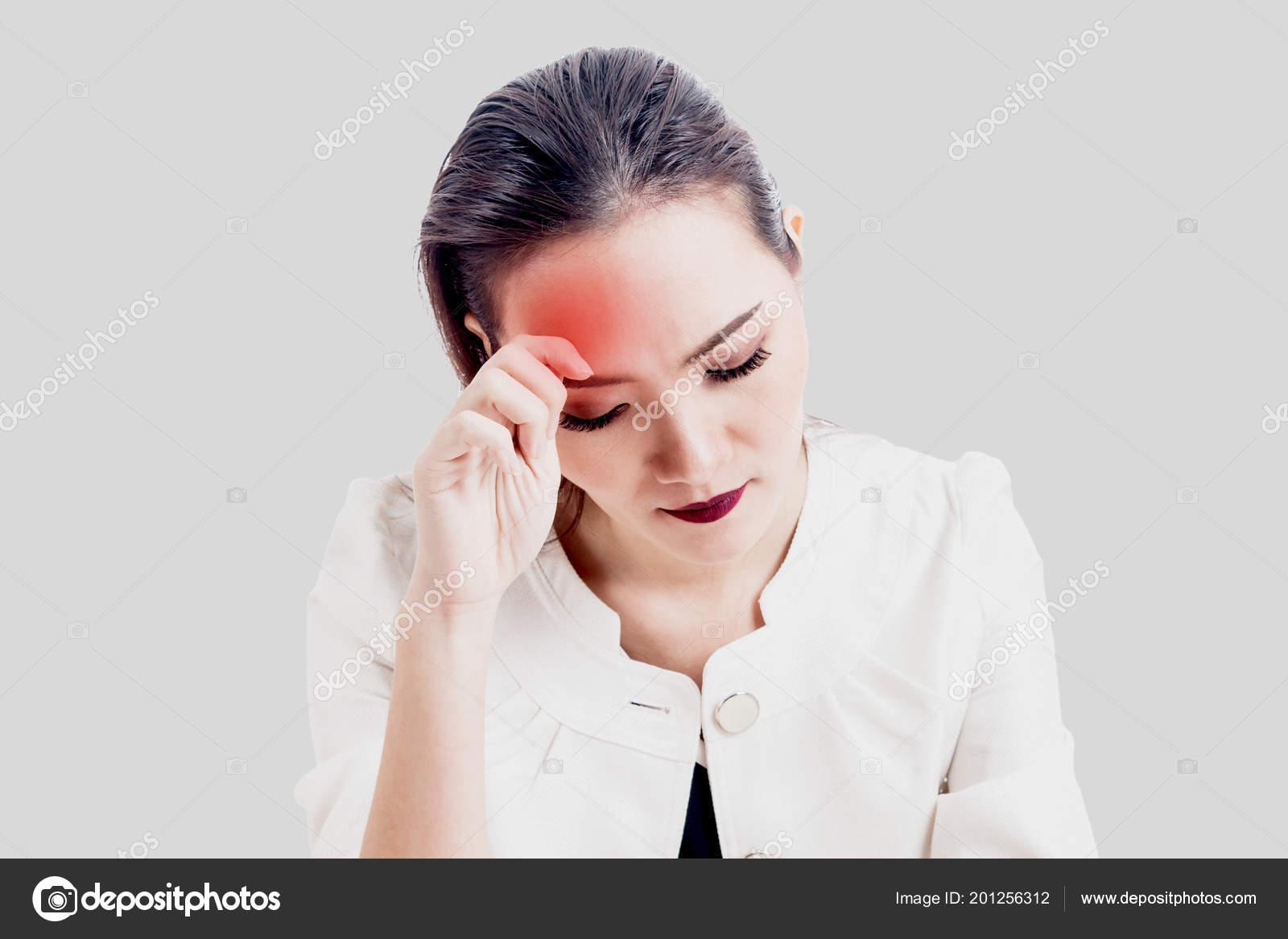 woman headache holding head