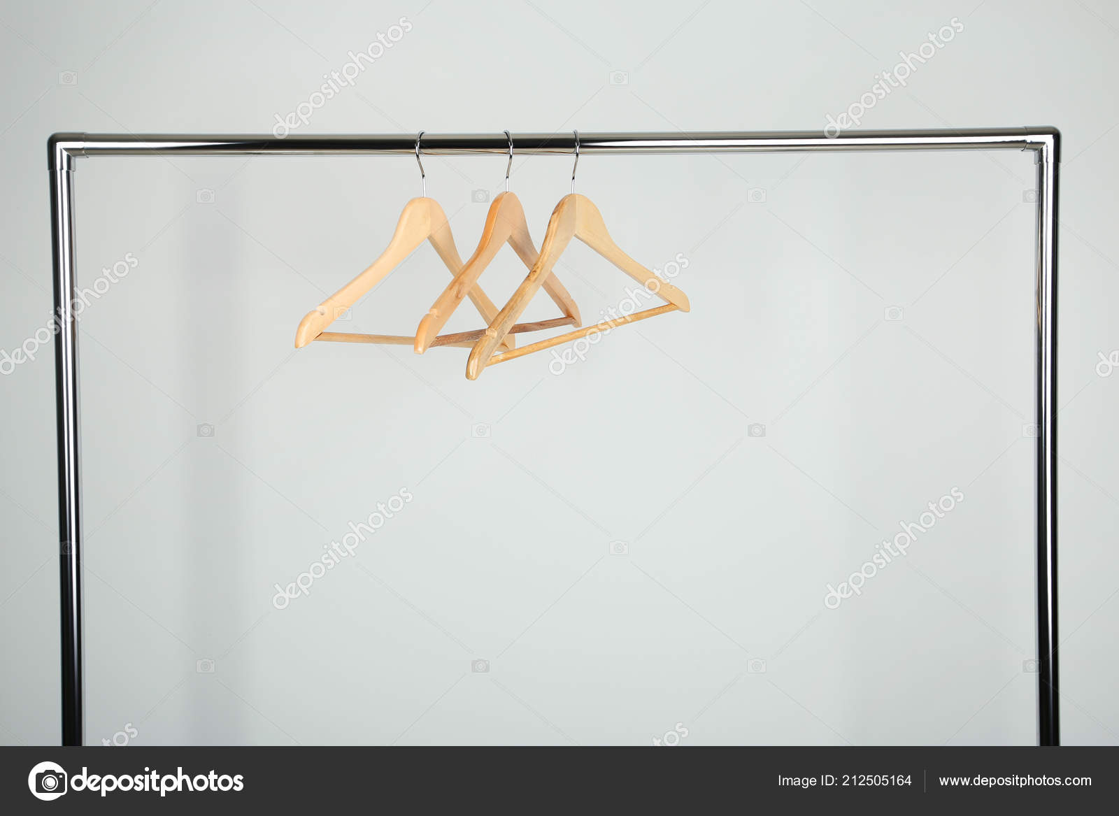 https depositphotos com 212505164 stock photo wooden clothes hangers rack white html