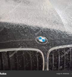 car repair car advertising car wash bmw advertising moscow 1 11 2018 bmw motor company badge in front of the black car bmw german company for the  [ 1600 x 1167 Pixel ]
