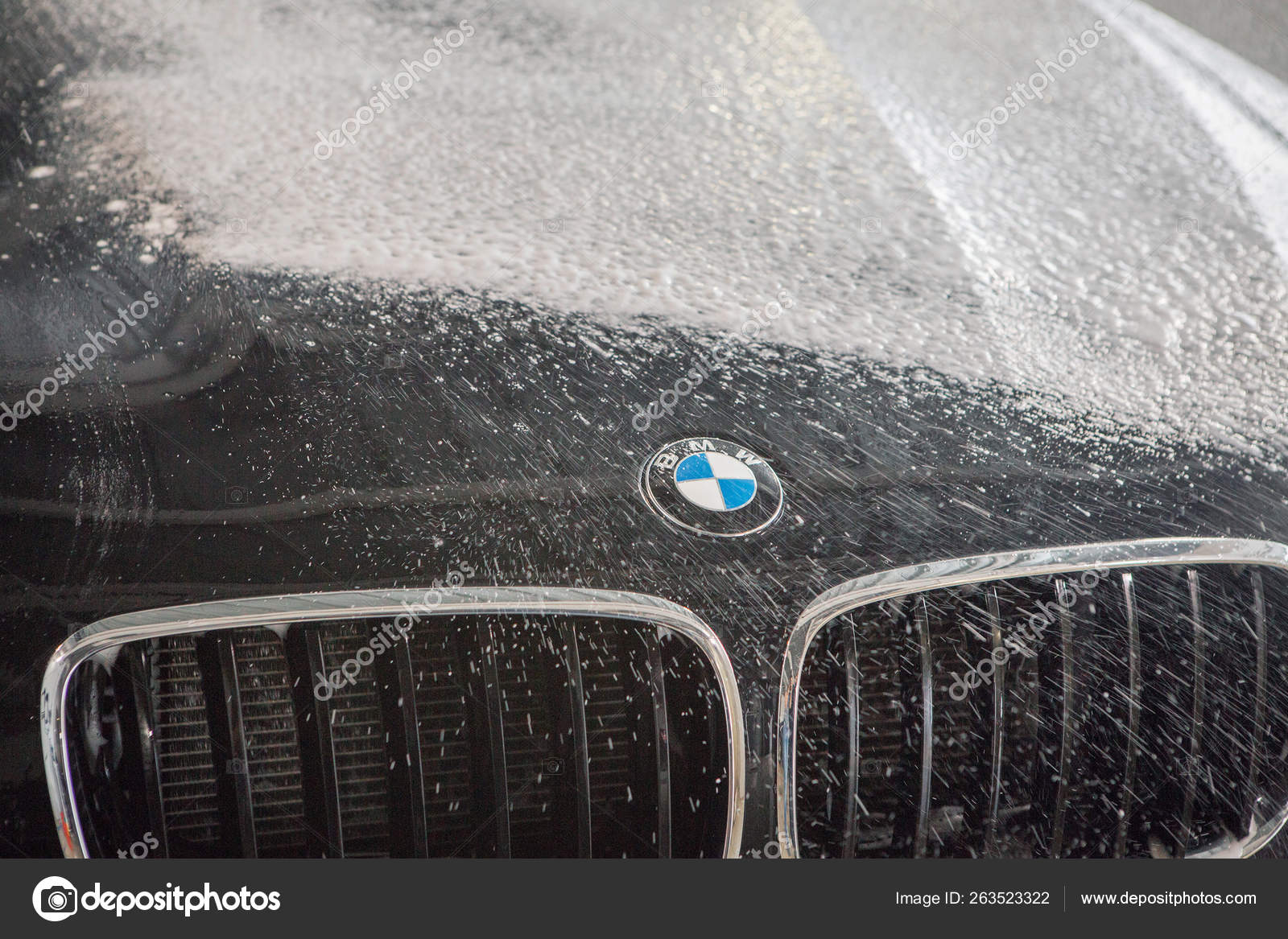 hight resolution of car repair car advertising car wash bmw advertising moscow 1 11 2018 bmw motor company badge in front of the black car bmw german company for the