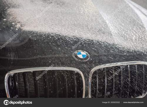 small resolution of car repair car advertising car wash bmw advertising moscow 1 11 2018 bmw motor company badge in front of the black car bmw german company for the