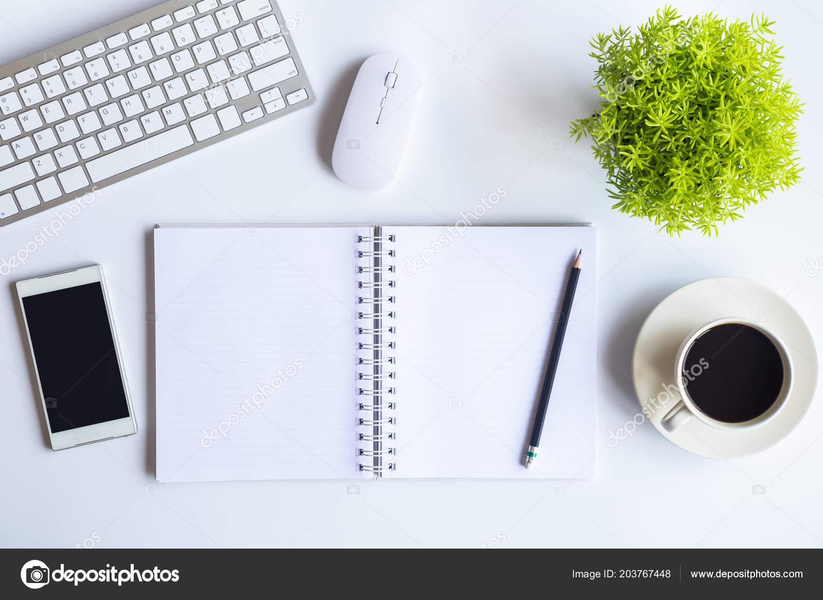 https depositphotos com 203767448 stock photo white desk office laptop smartphone html