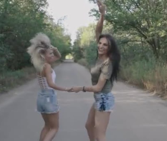 Two Best Friends Sexy Hot Girls Runnung And Having Fun Together On A Road At Forest