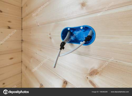 small resolution of a blue hood in the wall for an outlet or switch with a protruding insulated wire electric wiring in a wooden house stock image