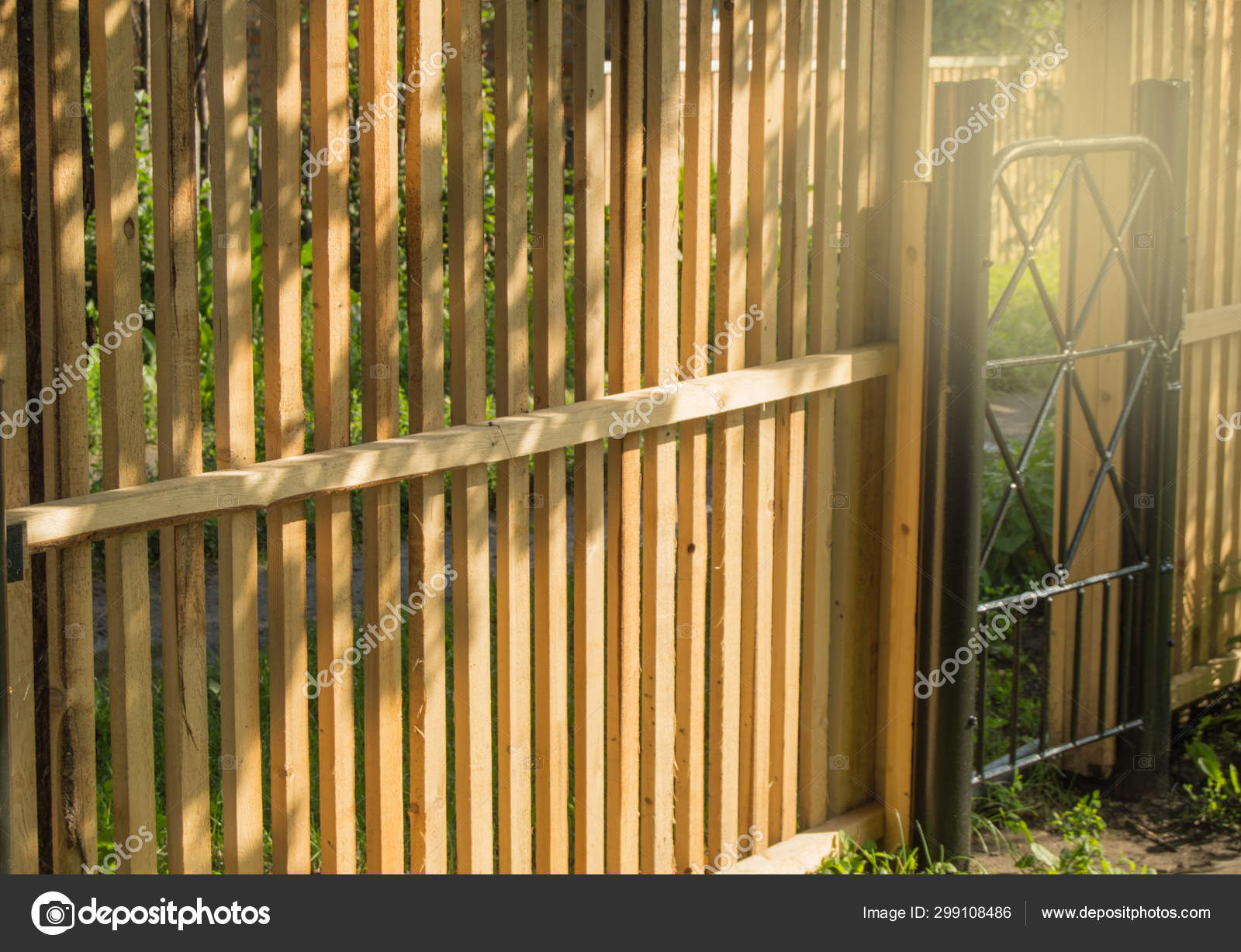 Rustic New Wooden Fence With Black Metal Posts And Gates Garden And Vegetable Garden Fence On A Sunny Summer Day Against The Background Of Plants And Trees Stock Photo C Esweta3 Gmail Com