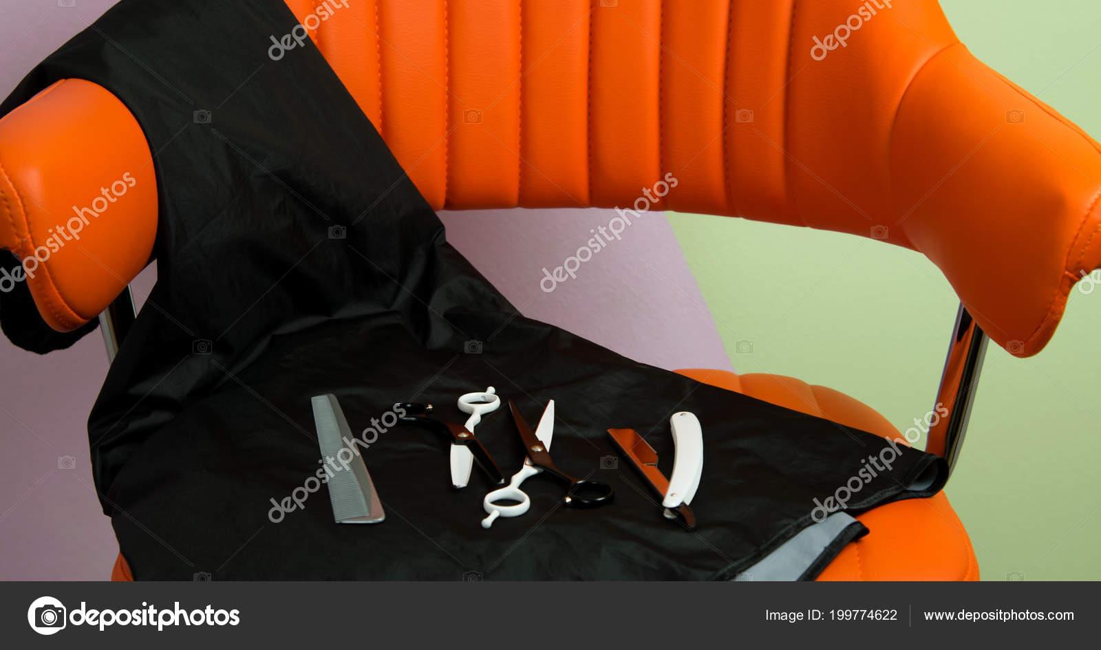 orange chair salon handicap mobile chairs beauty lie tools haircuts scissors shaving razor stock photo