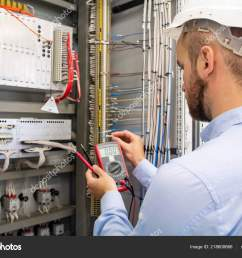 electrician technician in fuse box maintenance engineer in control panel worker is testing automation equipment engineering in electrical station  [ 1600 x 1167 Pixel ]