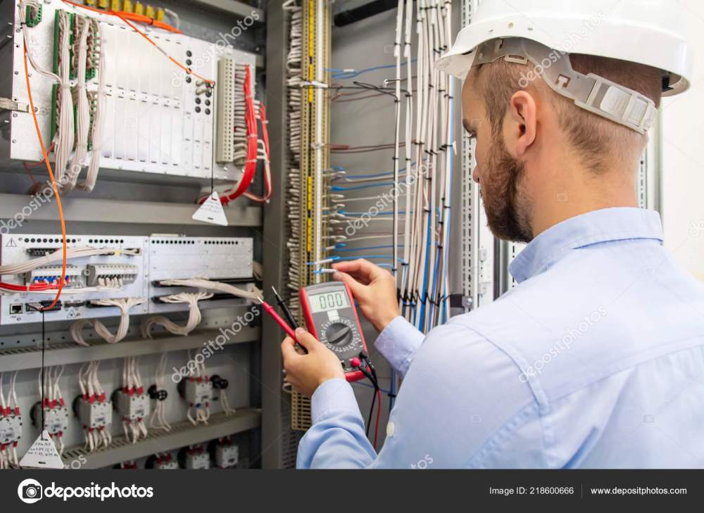 medium resolution of electrician technician in fuse box maintenance engineer in control panel worker is testing automation equipment engineering in electrical station