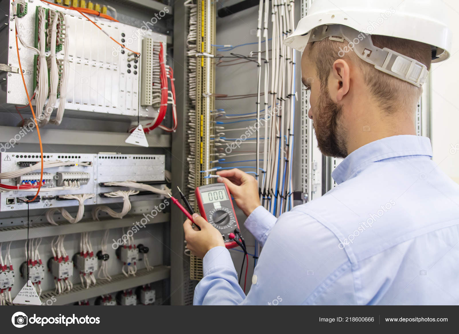 hight resolution of electrician technician in fuse box maintenance engineer in control panel worker is testing automation equipment engineering in electrical station
