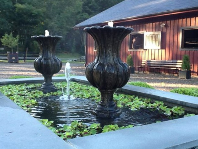 Fountains in the middle of the court yard outside the barn