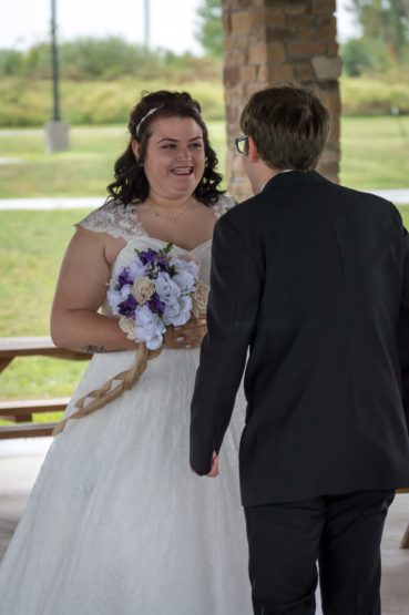 Bride and Groom smile after seeing each other for their First Look.