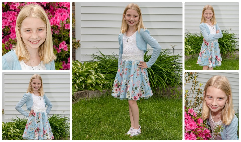 Girl in blue and white dress poses for her outdoor photography session.