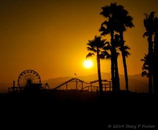 Santa Monica Pier silhouetted against setting sun