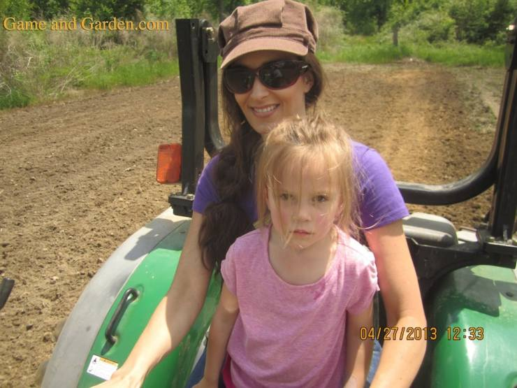 Milly After Nap Riding on Tractor