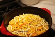Candied orange peels simmering in a saucepan