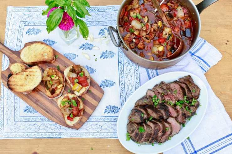 ratatouille served with steak and bread