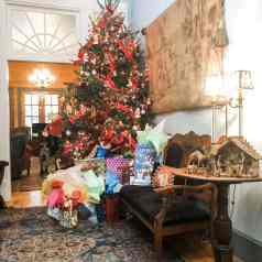 """Picture of a fully decorated Christmas tree in Stacy Lyn Harris's home, from her blog """"Perfect Christmas Gifts for the Special Men in your life"""""""