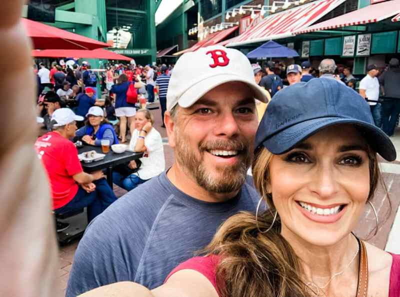 Stacy Lyn Harris at Boston Redsox game with her husband