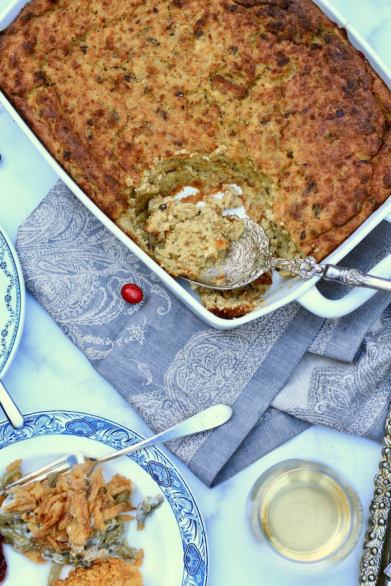 Thanksgiving Dressing in Rectangle Casserole Dish with Plate full of Casserole