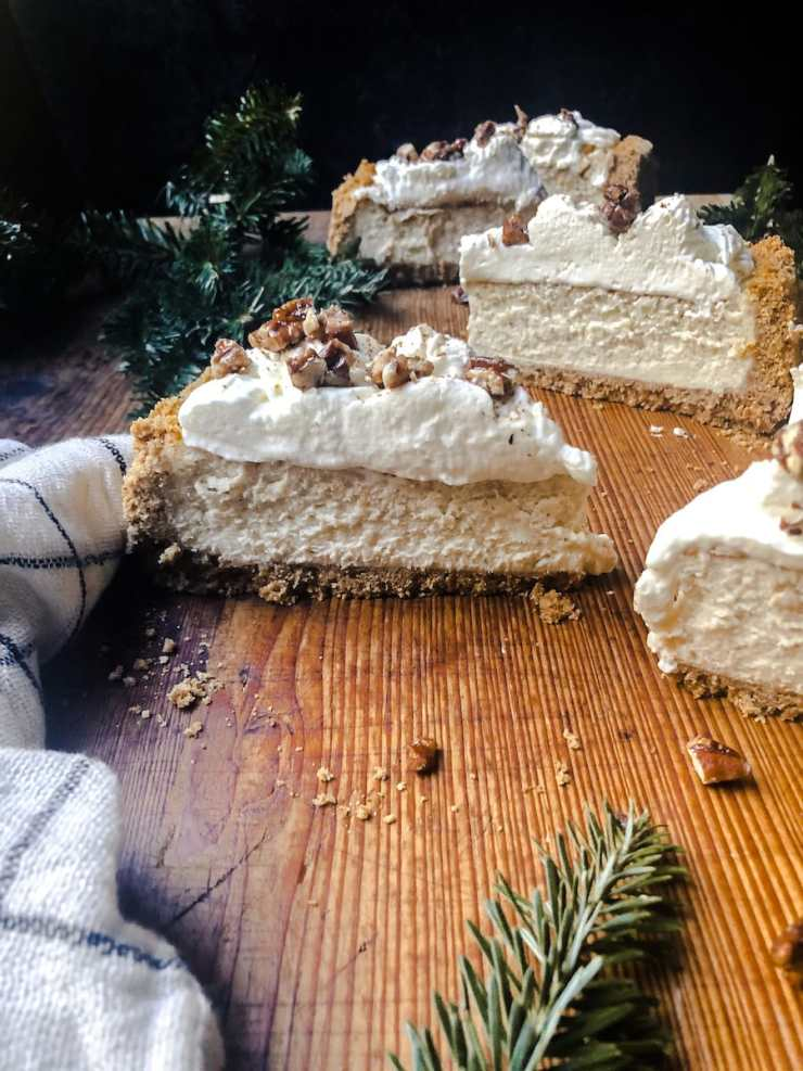 Eggnog Cheesecake on Wooden Board with Greenery