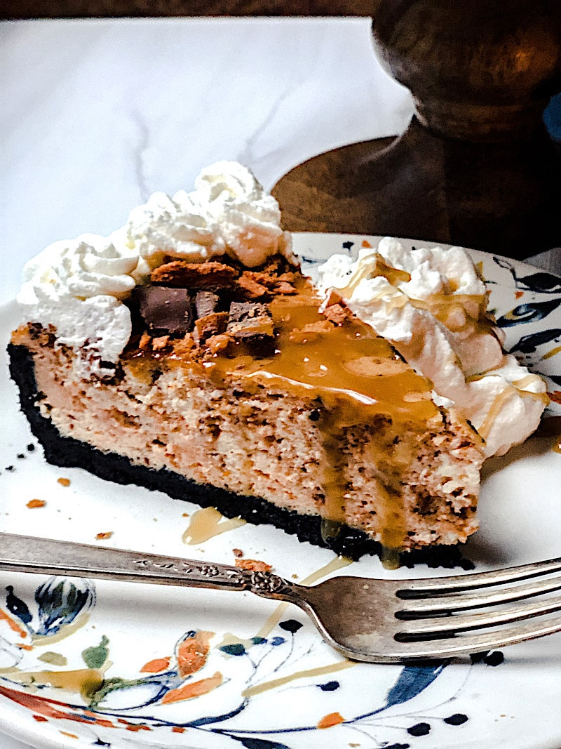 butterfinger cheesecake - the best version on Anthropolgy plate with antique silver fork.