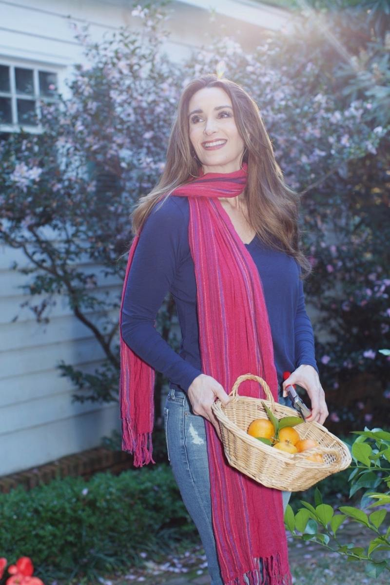 Stacy Lyn Harris in backyard with a basket of oranges