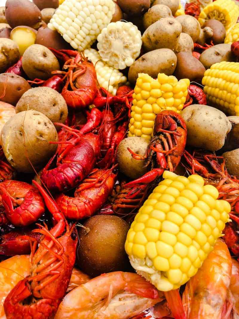 crawfish boil recipe close up of crawfish, corn, and potatoes
