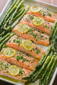 salmon, lemon slices, and asperagus