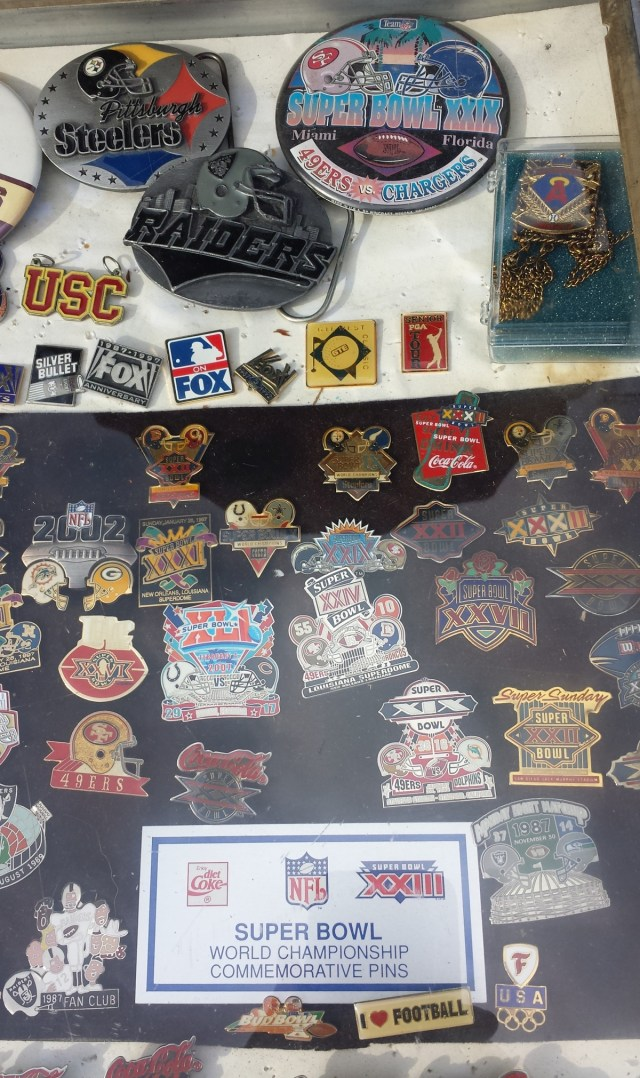 Assorted Super Bowl pins and other pins
