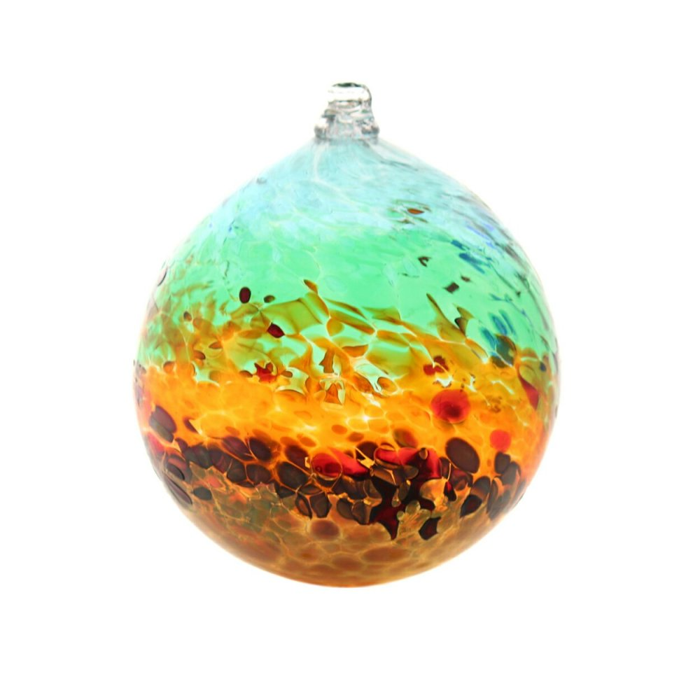 A handblown suncatcher with bands of color from reds and golds to blues and green. Nine inches in diameter, approximately.