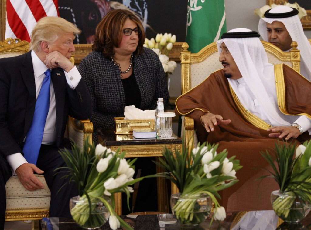 President Trump talks with Saudi King Salman after a welcome ceremony at the Royal Terminal of King Khalid International Airport in Riyadh in 2017. At left, Trump's former national security adviser Michael Flynn arrives at federal court in Washington in December.