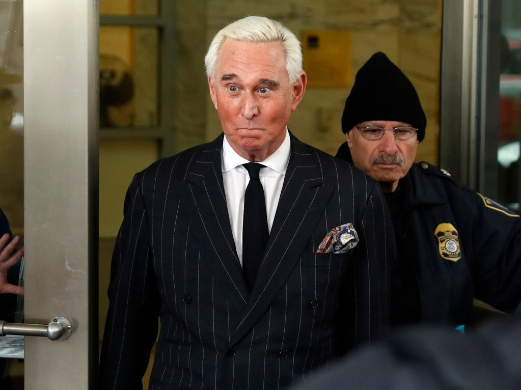 """In this Feb. 1, 2019, file photo, former campaign adviser for President Donald Trump, Roger Stone, leaves federal court in Washington. President Donald Trump's longtime confidant Stone has apologized to the judge presiding over his criminal case for an Instagram post featuring a photo of her with what appears to be the crosshairs of a gun. Stone and his lawyers filed a notice Monday night, Feb. 18, saying Stone recognized """"the photograph and comment today was improper and should not have been posted."""""""