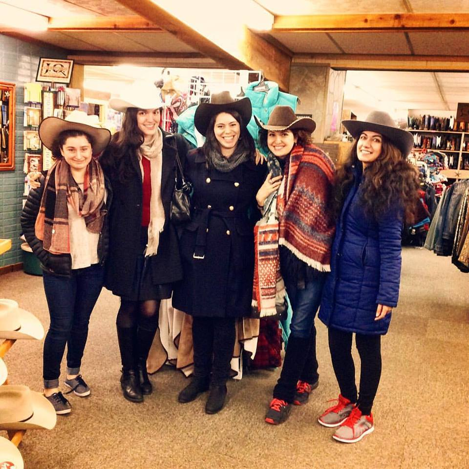[Photo courtesy of Adriana Popa | European Institute fellows trying on cowboy hats]