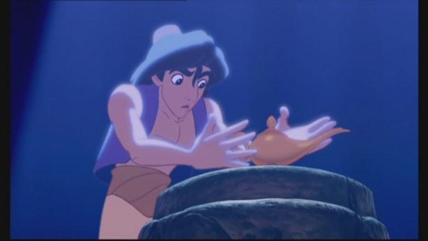 Aladdin grasps the lamp...