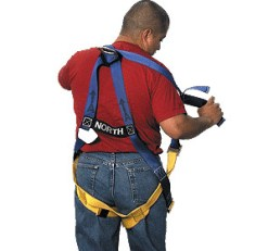 operator showing safety harness