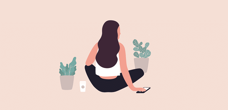 woman sitting with phone