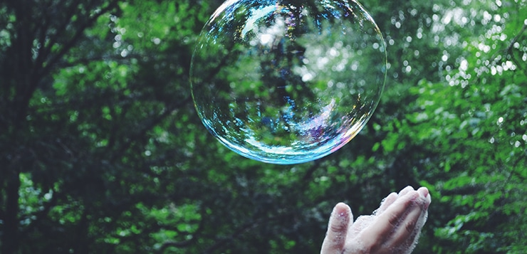 Hands reaching to bubble