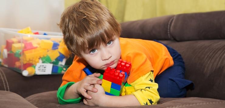 little boy keeps lego blocks to himself