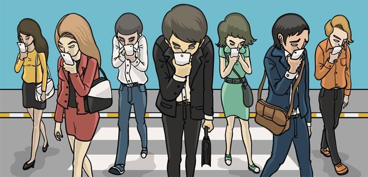people walking across street, staring at phones
