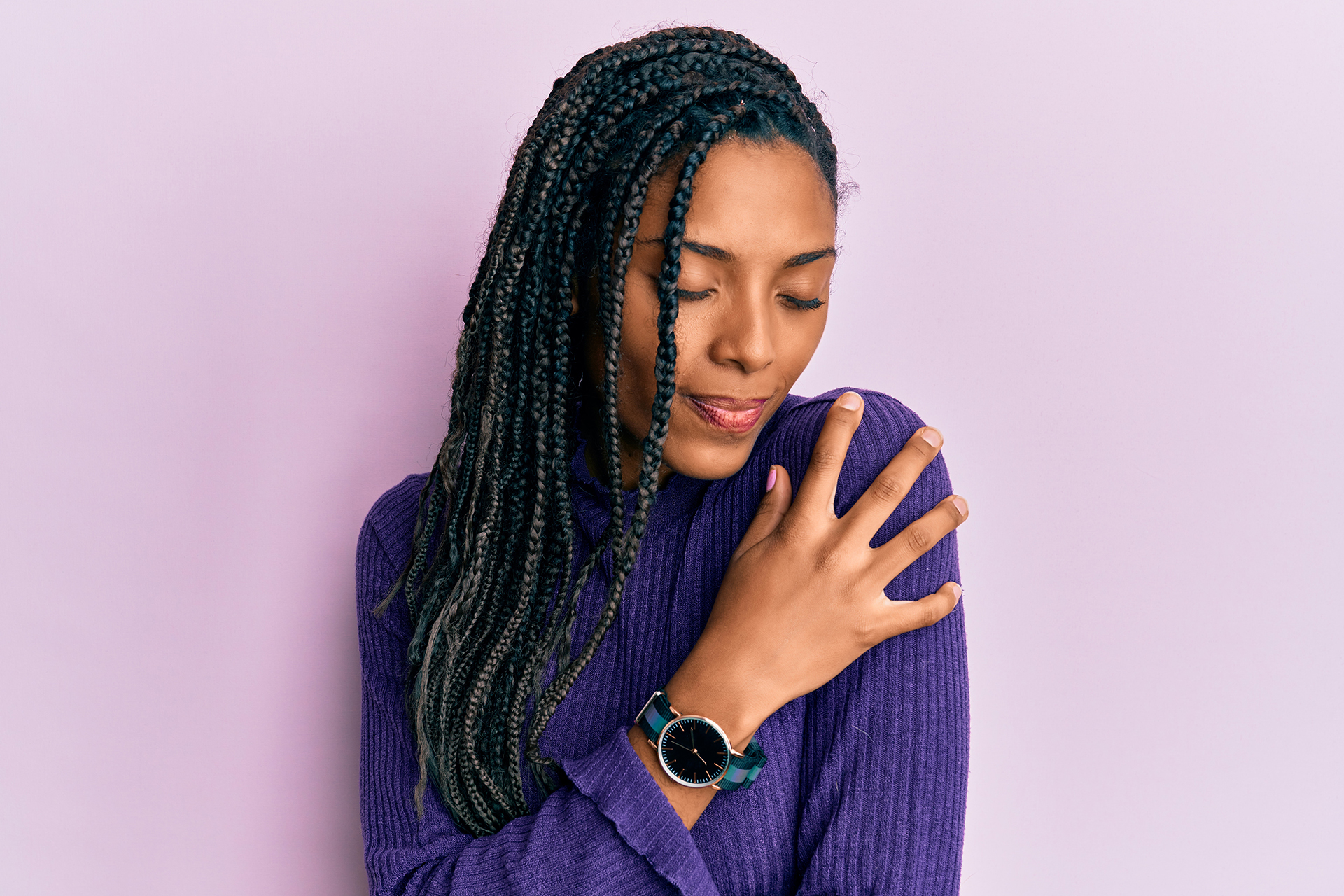 African american woman wearing casual winter sweater hugging oneself happy and positive, smiling confident. self love and self care