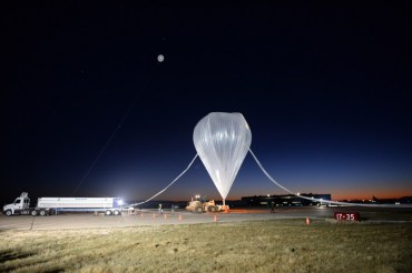 "A photograph showing the StratEx team filling a high-altitude balloon to take Google executive Alan Eustace to the Stratosphere on 24 October 2014 in Roswell, New Mexico. The 57-year-old Eustace, a ""senior vice president of knowledge"" at Google, set a new record by jumping successfully from near the top of the stratosphere -- some 135,000 feet, or 41,000 meters high -- as part of the Stratospheric Explorer project to allow manned exploration of the stratosphere above 100,000 feet. According to a statement from the Paragon Space Development Corporation, Eustace completed the four-hour mission using a specially designed space suit and balloon module to carry him to the stratosphere. Source: AFP 2014 / Paragon Space Development Corporation$ )$"