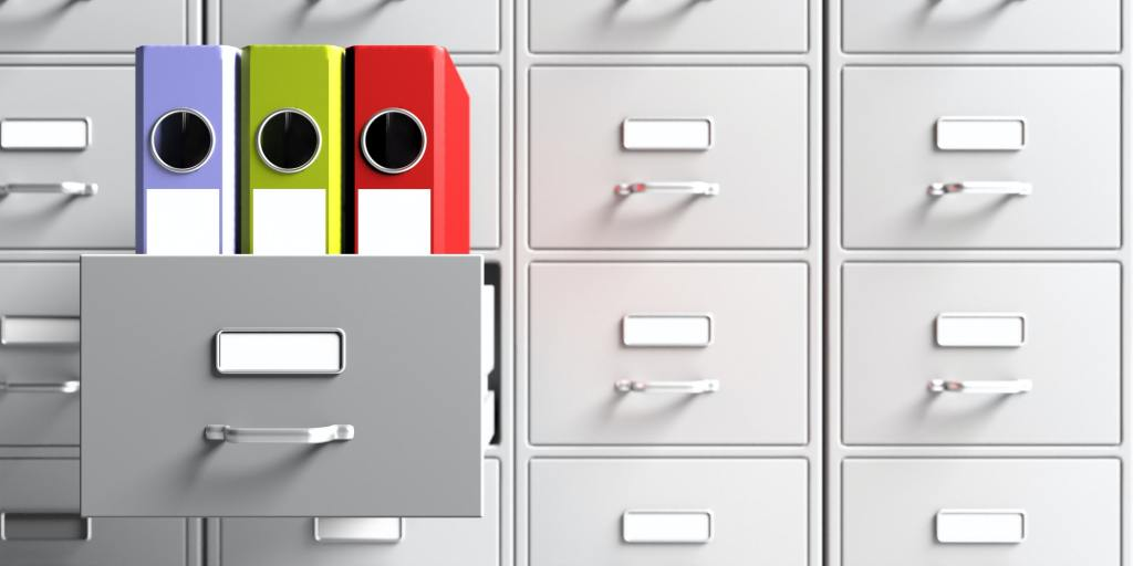 Office document binders in a filing cabinet drawer. 3d illustration