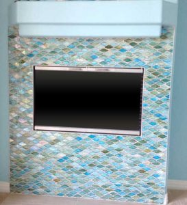 Beautiful Aqua, blue and sea foam colored glass tile fireplace
