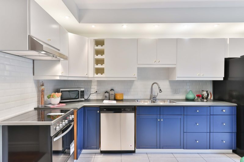 Another creative design trend is painting cabinetry bright colors