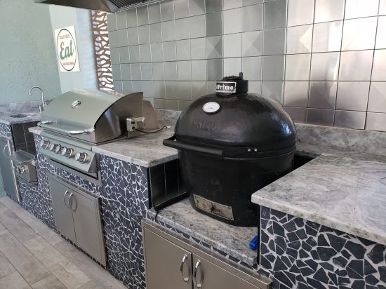 Gourmet Outdoor Kitchen with Stainless Steel Backsplash
