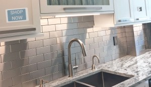 Stainless Steel Tile backsplash compliments this dreamy kitchen