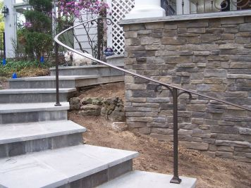 wrought iron rail and marble stairs