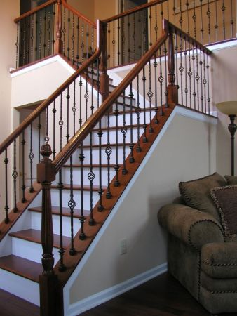 metal stairs with wood banisters_15