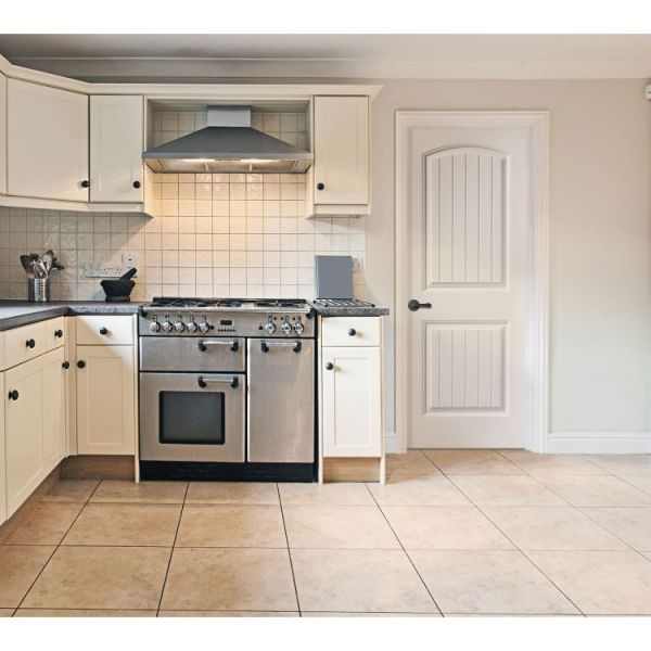 white cheyenne panelled and moulded interior door in bright minimalist kitchenette
