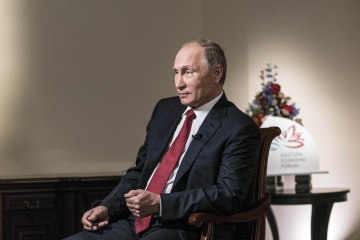 Vladimir Putin, Russia's president, pauses during an interview in Moscow, Russia, on Thursday, Sept. 1, 2016. Photographer: Jeremy Liebman/BloombergBusinessweek